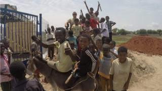 African children at new water treatment plant
