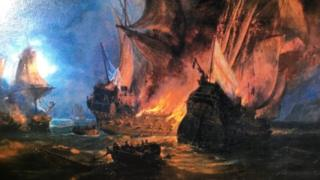 A painting shows several ships burning on the sea - the closest of which, bearing an English flag, is sinking