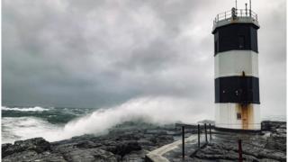 Waves crash on rocks near Rue lighthouse on Rathlin Island