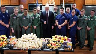 US President Donald Trump poses as he visits with personnel at US Coast Guard Station Lake Worth Inlet in Riviera Beach, Florida, on Thanksgiving Day, November 22, 2018.