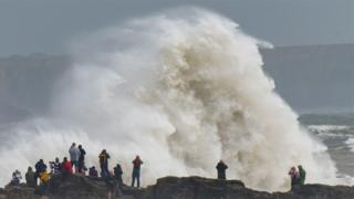 Wave crashing over rocks