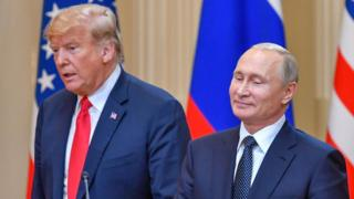 US President Donald Trump (L) and Russia's President Vladimir Putin arrive to attend a joint press conference after a meeting at the Presidential Palace in Helsinki, on July 16, 2018