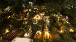 Mexican cemetery lit with candles