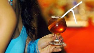 A Sri Lankan woman holds a cocktail during a drinks competition in Colombo, 26 February 2017