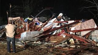 A handout photo released 29 November by the Colbert County Emergency Management Agency shows tornado damage to a home near Tuscumbia, Alabama.