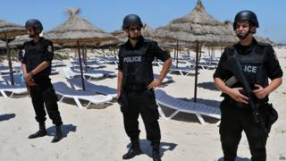 Armed police on beach at Sousse. 3 July 2015