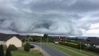 Huge dark cloud over mountains