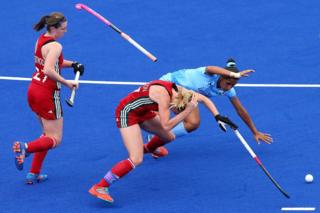 Leah Wilkinson of Wales clashes with Rani of India during a hockey match