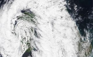 A Met Office satellite picture shows a map of the UK covered by a rain cloud