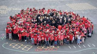 West Ewell Primary School in Surrey gathered in the shape of a poppy to mark the WW1 centenary.