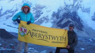 Postgraduate researcher Katie Miles and Prof Bryn Hubbard with the Khumbu glacier is in the background