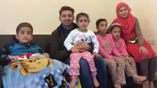 Manar with her four sisters and Newsround reporter Ricky