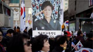 Supporters of South Korean President Park Geun-hye attend a protest near the constitutional court in Seoul, 9 March 2017