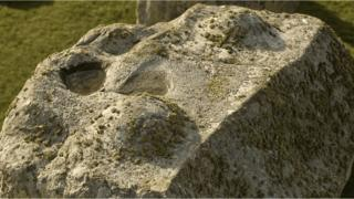 stonehenge-top-with-dips-and-bumps-covered-with-moss