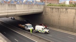 Police at scene of Westlink crash