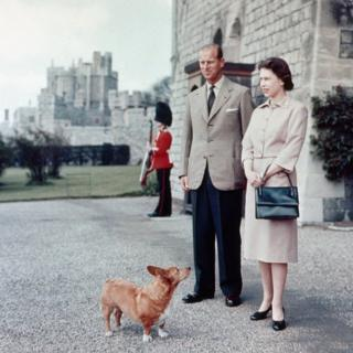 Queen Elizabeth II and Duke of Edinburgh at Windsor joined by Sugar, one of the Royal corgis