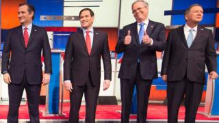 Jeb Bush, Ted Cruz, Marco Rubio and John Kasich stand on stage before a Republican debate in Iowa.