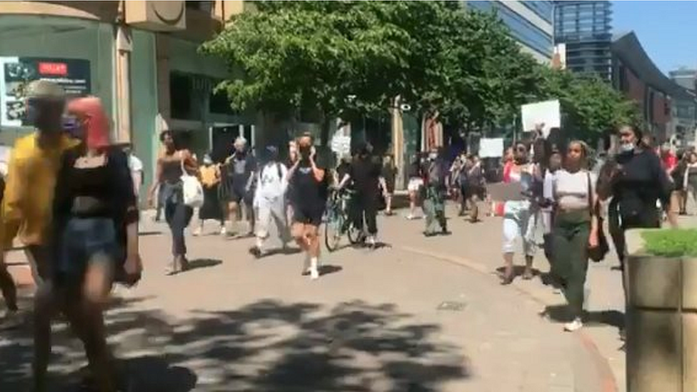 Anti-racism campaigners march through Manchester city centre