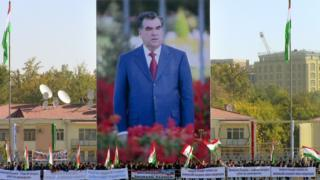 People wave flags in front of an image of President Emomali Rakhmon