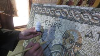 An ancient mosaic is painted with an invisible liquid that is detectable under ultra-violet light