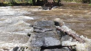 Damaged Tarr Steps under water