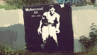 Muhammad Ali mural painted on gates in derelict site