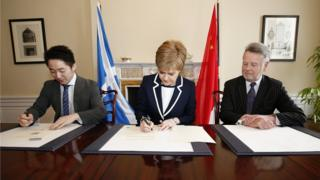 Nicola Sturgeon signing deal