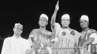 Prime Minister Kwame Nkrumah (center) waves to celebrating crowd here March 6th after the British colony known as the Gold Coast ceased to exist and the sovereign state of Ghana came into being