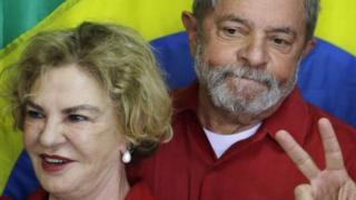 """Brazil""""s former President Luiz Inacio Lula da Silva, right, stands with his wife Marisa Leticia in 2014"""