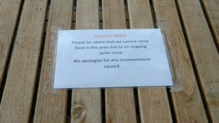 Sign on a table in JD Wetherspoon alerting customers food is not being served