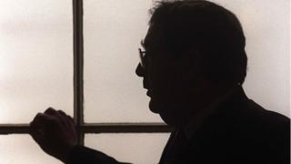 positive news John Hume in silhouette