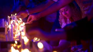 Egyptians light candles during a candlelight vigil