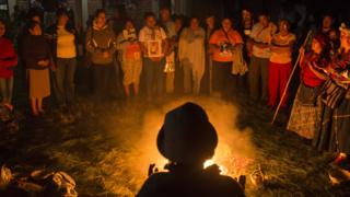 A Mayan ceremony is offered to the families of the disappeared migrants by the people the people of la Ceiba