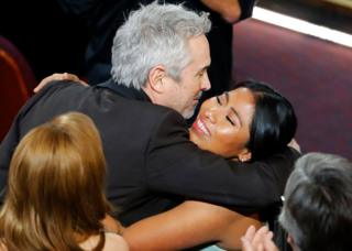 Alfonso Cuaron hugs Yalitza Aparicio