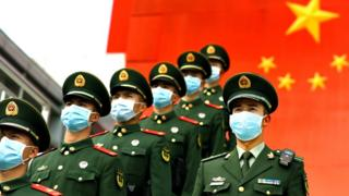 Chinese policemen with face masks