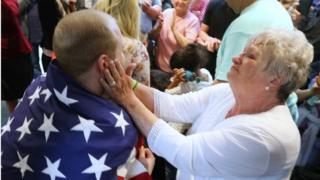 Grandmother hugs grandson