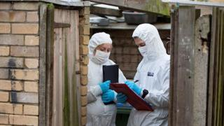 Forensics officers at the address