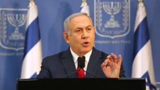 Israel's Prime Minister Benjamin Netanyahu delivers a statement to the members of the media in Tel Aviv, Israel