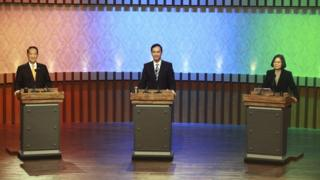 """Taiwan's 2016 presidential election candidates with (L-R) People first Party's James Soong, KMT or Nationalist Party""""s Eric Chu, and Democratic Progressive Party's, DPP, Tsai Ing-wen, at the start of their first televised policy debate in Taipei, Taiwan, 27 December 2015."""