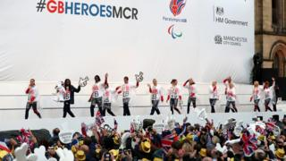 Athletes walk out onto the stage in Albert Square in Manchester