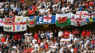 Wales and England fans and flags in Lens