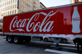 A Coca-Cola truck makes its way through downtown Los Angeles, California