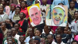 People dance as they await the arrival of Pope Francis at the Kasarani Stadium in Nairobi on 27 November 2015 for a meeting with youths - Kenya