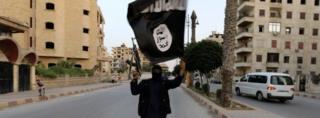 Islamic State militant waving flag in Raqqa
