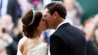 "Princess Eugenie and her new husband Jack Brooksbank kiss as they leave St George""s Chapel in Windsor Castle following their wedding"