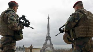 Soldiers patrol near the Eiffel Tower