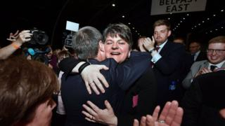 DUP leader Arlene Foster is hugged by deputy leader Nigel Dodds at the count centre in Belfast, Northern Ireland