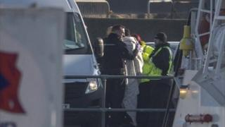 Border Force officers with migrants at Dover