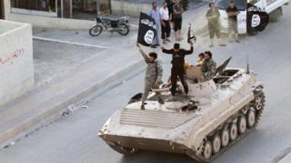 IS fighters in Raqqa, June 2014