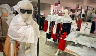 Jarrold mannequins wrapped in tissue paper